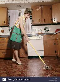 Kitchen Floor Mop 1960s Woman In Apron Cleaning Kitchen Floor With Sponge Mop Stock