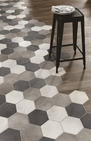 black and white hexagon tile floor. hex tile to wood floor transition woodplace / ragno - marazzi group, love this style. black and white hexagon