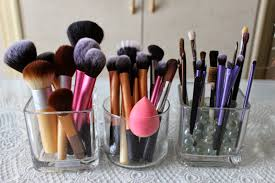 dust free makeup brush holder. i decided to get two square vases from the dollar store, keep on top of my bedroom vanity in front which do makeup. with a few more brushes dust free makeup brush holder