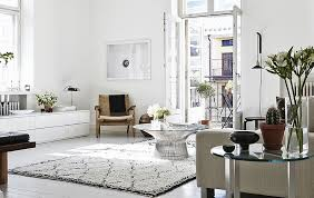 ... Smart Platner coffee table sits at the heart of this lovely living room  [Design: