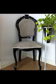 a sleek gloss black french italian dining chair with stone very fluffy fabric added with a golden lace trim