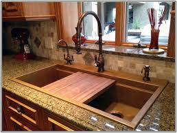 oil rubbed bronze kitchen faucet and copper drop in kitchen sink with cutting board