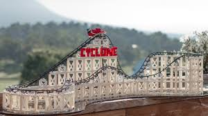 The Cyclone is a working roller coaster model kit that is compatible with  the world's leading