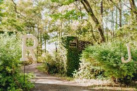 bride and groom s initials hang by entrance of ceremony brookgreen gardens murrells inlet