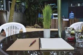 a glass table cover adds protection from spills and wear