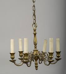 continental brass six light chandelier with baer turned standard scroll work arms candle cups and bobeche