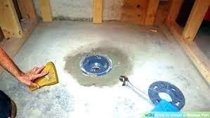 installing a shower base on concrete floor post pan drain replace