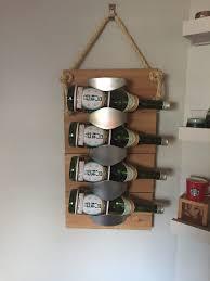 Ikea Vurm wine rack attached to cedar planks.