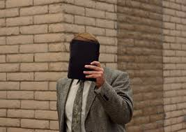nd place photo essay polygamy s hidden face trenthead polygamist kelly fischer covers his face as he walks into the kingman arizona courthouse facing charges of sex a minor fischer a follower of flds