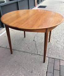 mid century modern round extendable dining table