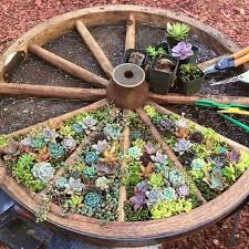 Small Picture Best 25 Wagon wheel garden ideas on Pinterest Wagon wheels