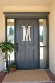exterior decorative front door plants closed to grey front entry door with letter m sign small