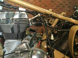 need help routing the wiring loom royal enfield desert storm and i was wondering what the best way is to route the loom especially around the bracket head steady in the following pic