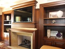 brown wood fireplace with mantel shelves and double shelves cabinet