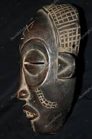 african tribal wooden hand carved mask from congo photo by