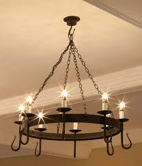 shepherd s crook 8 light round wrought iron chandelier in natural black with ivory candle s