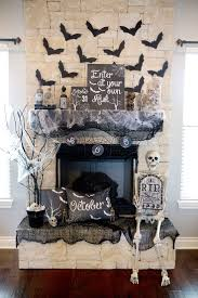 Halloween Mantel Decor Spruce up your fireplace with cutout bats. Make it  even spookier with skeletons, webs and spray painted branches.