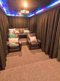 home theater room. i like the lighting at top/ceiling. - a diy home theater room- hang curtains around your seats for increased darkness during show room o
