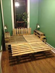 9 ways to create bed frames out of used pallet wood pallet furniture i like the tall platform look this has but i would need space i the center