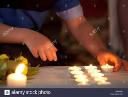 alter lighting. A Child Lights Candle At The Alter Of Magdalene Church Beginning Memorial Service For Killed, Seven Year Old Mary-Jane In Zella-Mehlis, Lighting