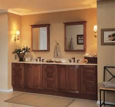 double wooden frames mirrored front recessed medicine cabinet with cream granite vanity sink top and bronze