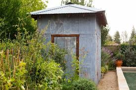 recycled materials such as corrugated metal siding can be transformed into charming garden sheds see