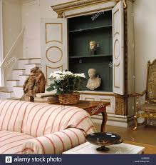 striped sofas living room furniture. Striped Sofa In Nineties Living Room Designed By Chester Jones With Classical Busts And A Painted Cupboard Sofas Furniture U