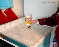 applying coat of mod podge on kitchen counter thriftyrebelvintage com