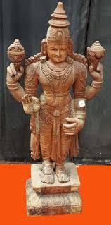 wooden carved indian vishnu statue
