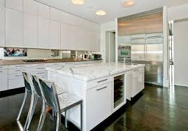 modern white kitchen with arabeo carrara marble countertops