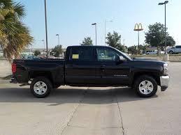 Black Chevrolet Silverado 1500 in Odessa, TX - 3GCUKREC1JG269687