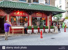 chinese restaurant outside. Man Taking Photograph Outside Red And Green Exterior Of The Chinese Restaurant For