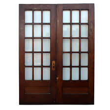 sold pair of salvaged 64 divided light french doors with beveled glass