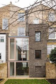 Gundry Ducker adds sooty brick and glass extension to London house
