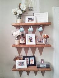 Small Picture Rustic Unstained Wooden Wall Shelves For Keeping Frame Picture And