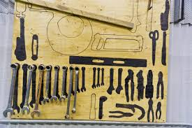 tools and their outlines hang on a wall inside an electrical power plant sand point southwestern alaska usa summer