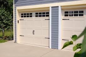 carriage house garage door with black handles and hinges