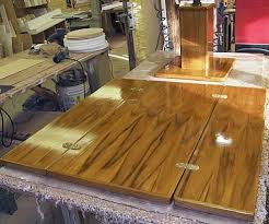 this fold over table top is an example of plantation teak wood finished in new gloss all wood awl grip for extreme durability dim are 40 x 40 when open