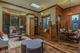 Otherwise, the home was rebuilt inside and out with Oregon wood. Custom  crown molding, shuttered windows, doors, and built-in storage are all made  from ...