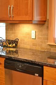 beige tile backsplash and grey granite countertops of adorable