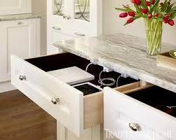 keep electronics off the counter by setting up charging station drawers with outlets in the back charging station kitchen central office