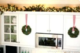 greenery above kitchen cabinets greenery above kitchen cabinets decorating above kitchen cabinets with greenery