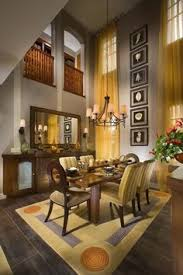 Decorating very high walls covering windows from top to bottom and with  artwork playing with the