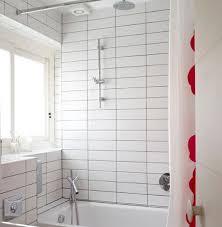 bathroom white tiles: dark grout white tile stacked rectangular white tiles with light gray grout house to