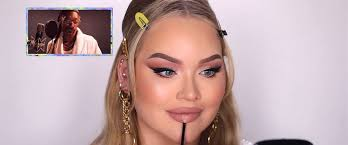 photo nikkie de jager applies makeup to her face in a makeup tutorial posted to
