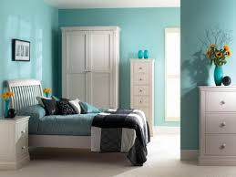 Good color combination interior bedroom theme white and blue color with sun  flowers decoration
