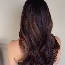 dark brown hair with thick caramel highlights