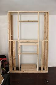next once the walls were up and secure j built out a cubby for the fireplace to slip into j built the opening per the instructions that came with the