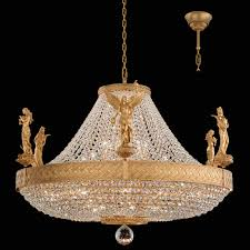 chandelier adorned with sparkling crystal chains and adorned with bands of gleaming gold three detailed figurines symbolize love fortune victory and