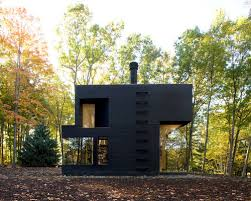 Example of a minimalist black two-story exterior home design in New York